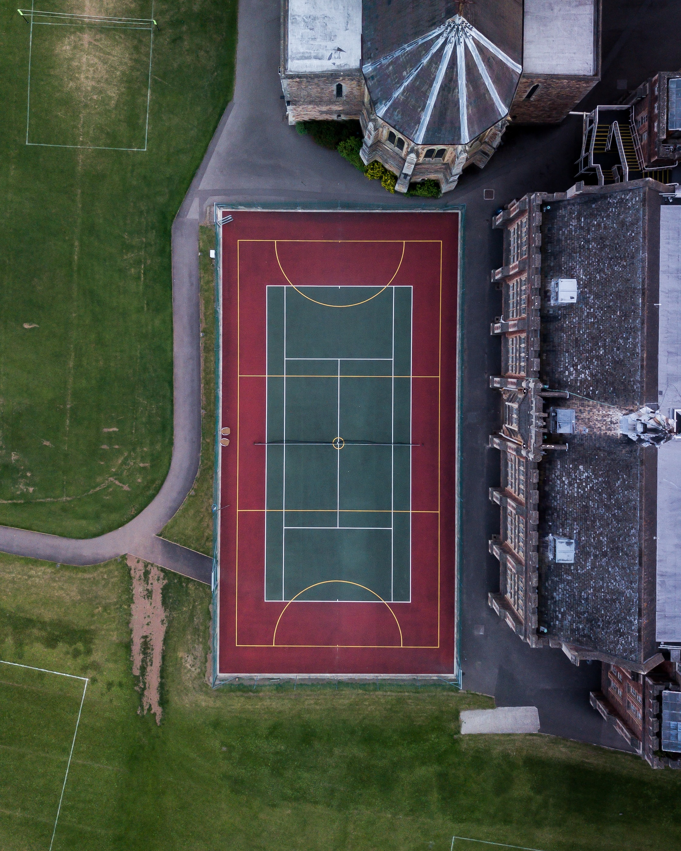 aerial photo of green and red sports field