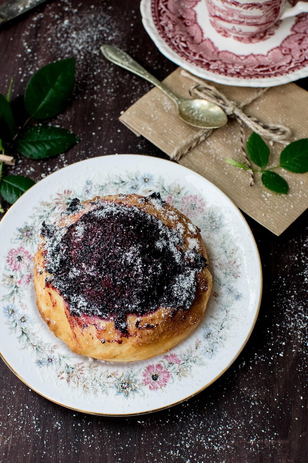yeast bun with honey and blackcurrant jam