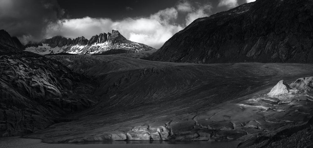 snow-capped mountain in grayscale photography