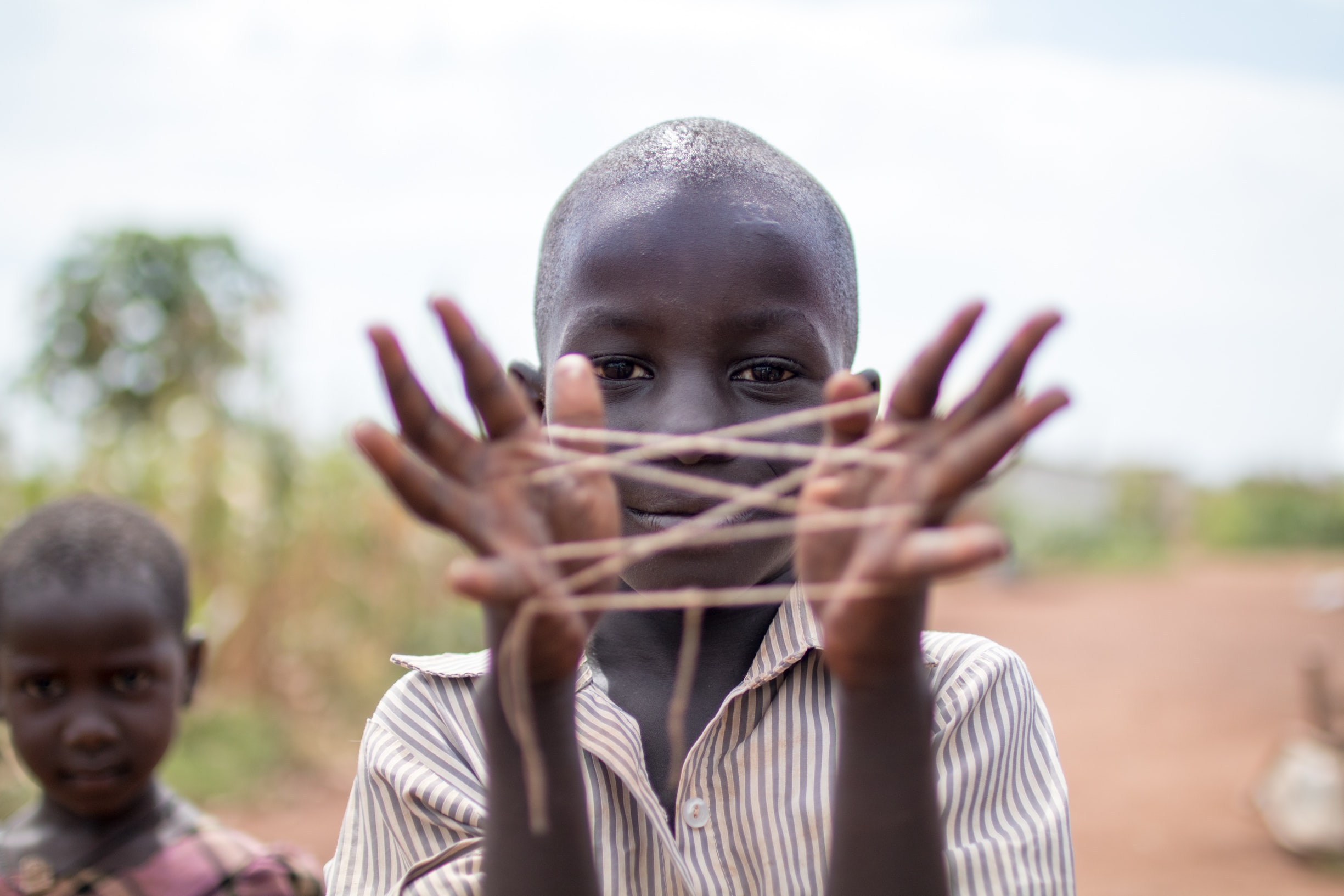 boy showing hand with rubber