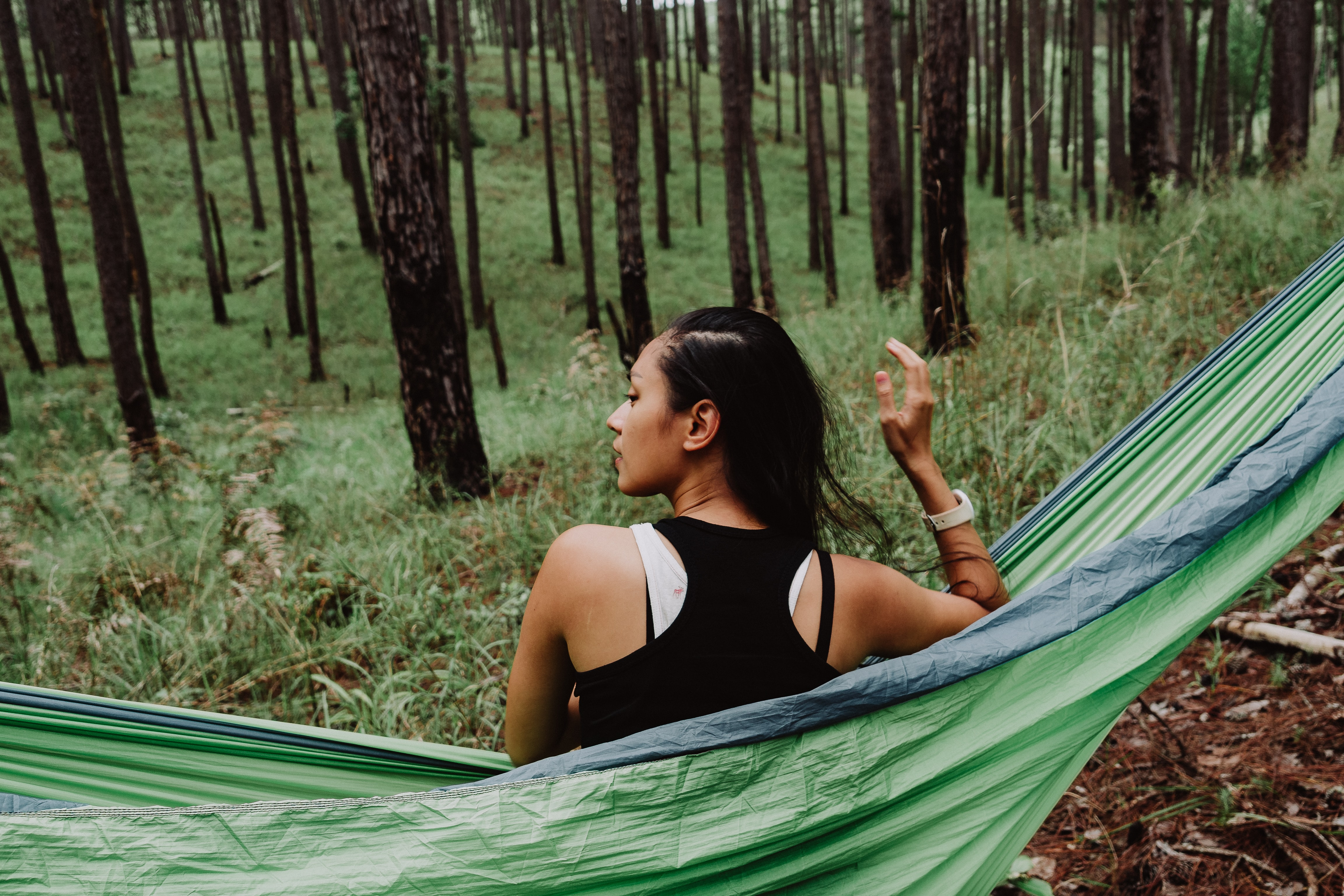 A young woman on a hammock in a forest in Dalat