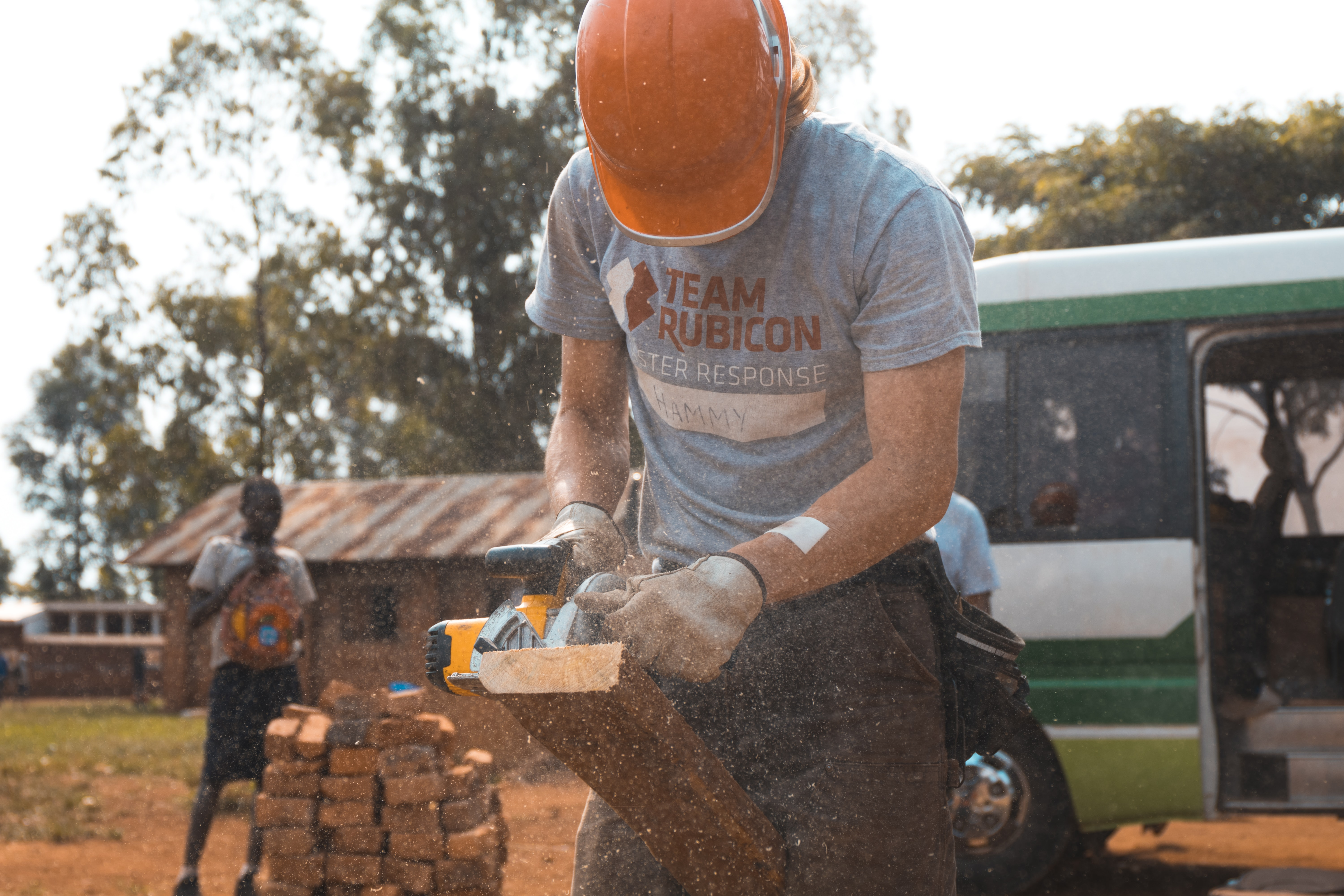 A man from a relief organization helps rebuild after a disaster in Uganda