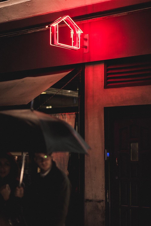 man under black umbrella