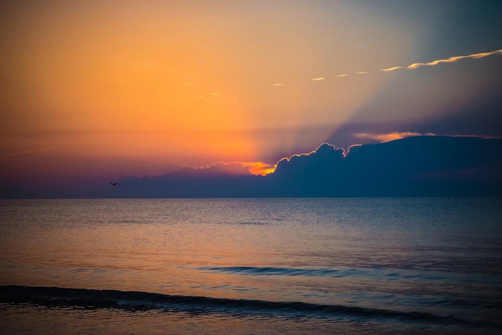 landscape photo of seashore at golden hour