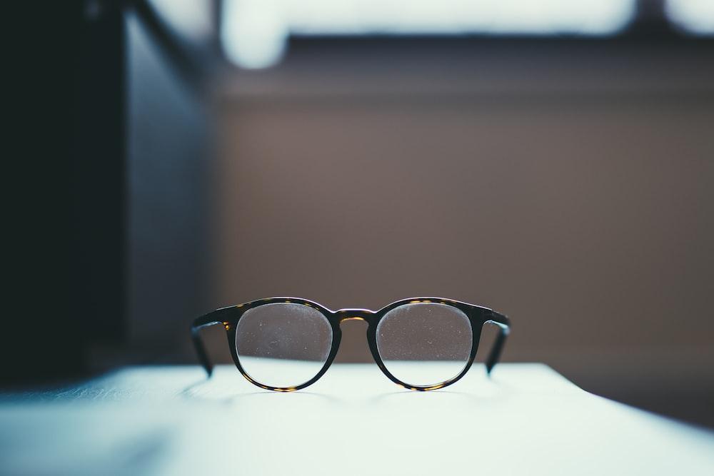shallow focus photography of eyeglasses
