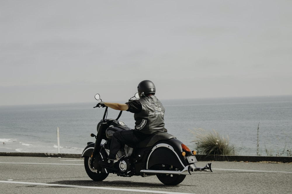 man riding on black motorcycle