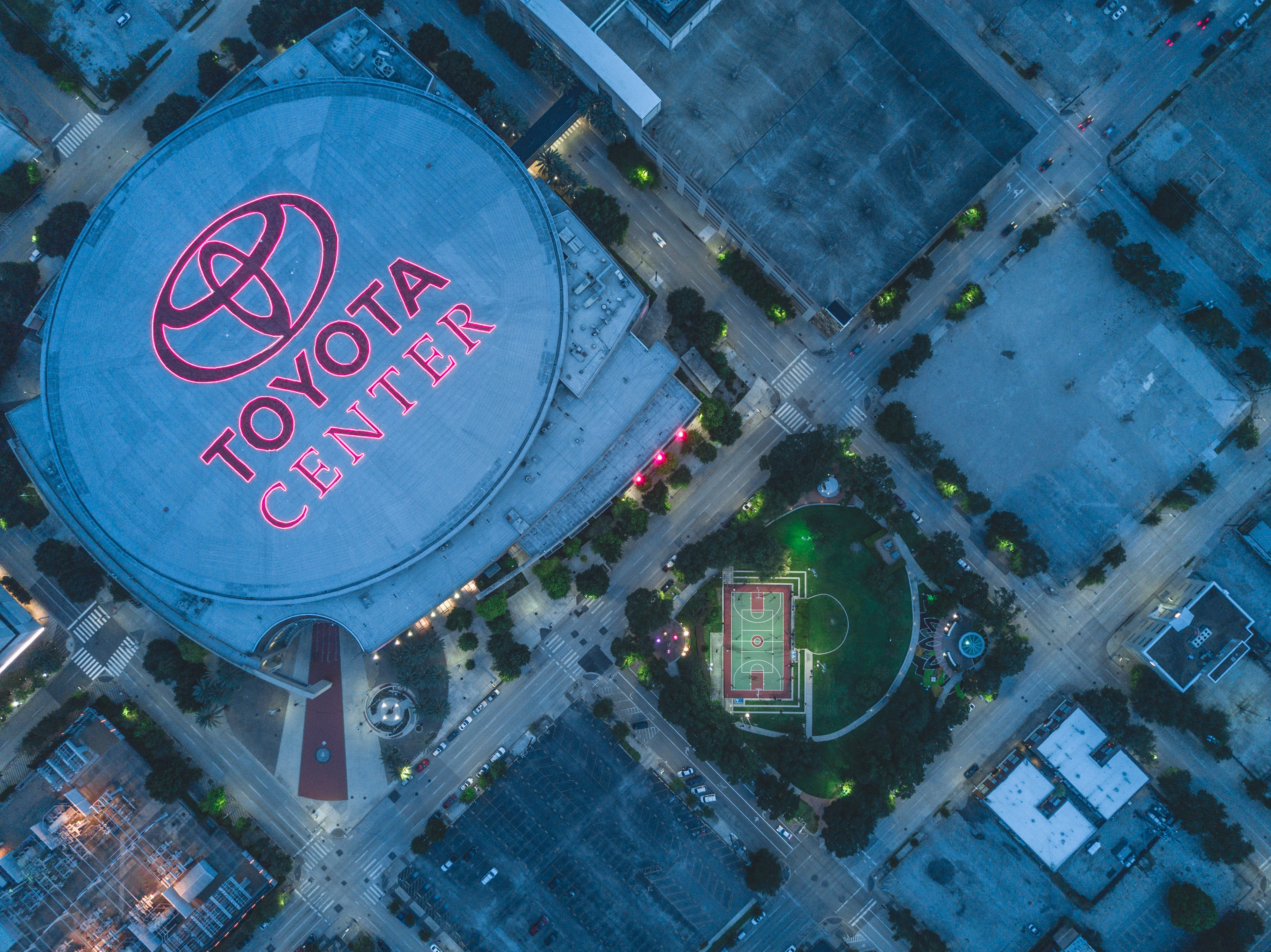 Drone view of Toyota Center and surrounding pitch and buildings
