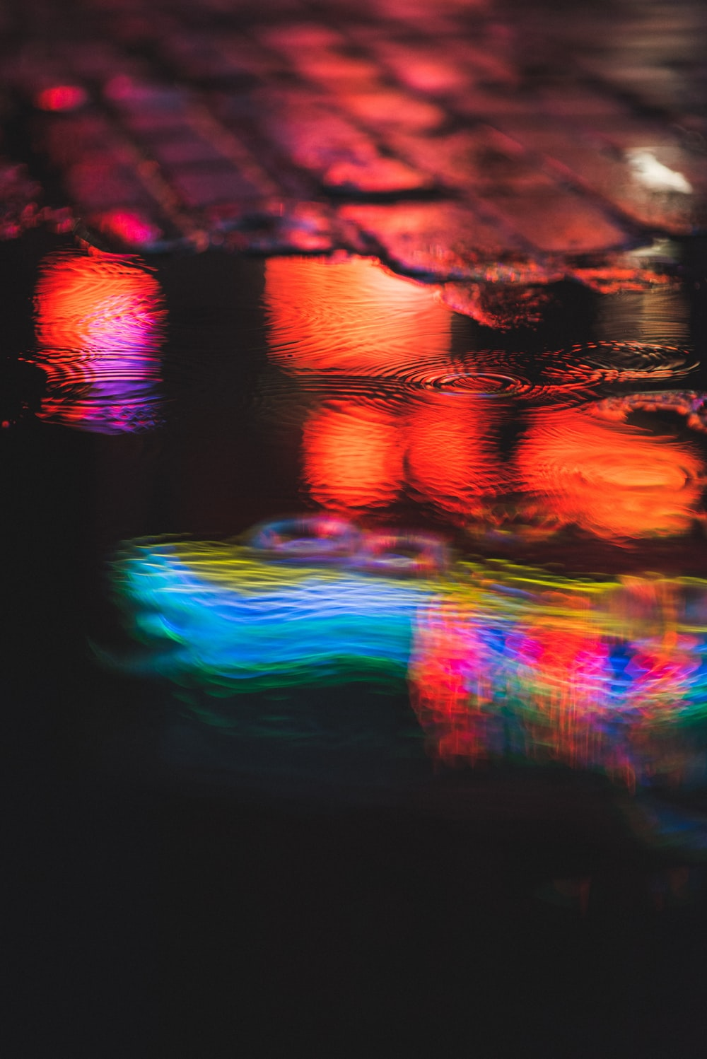 red and blue light reflection on water