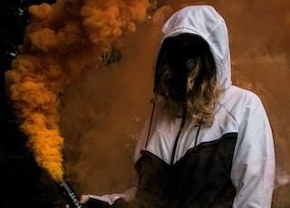 person holding orange smoke