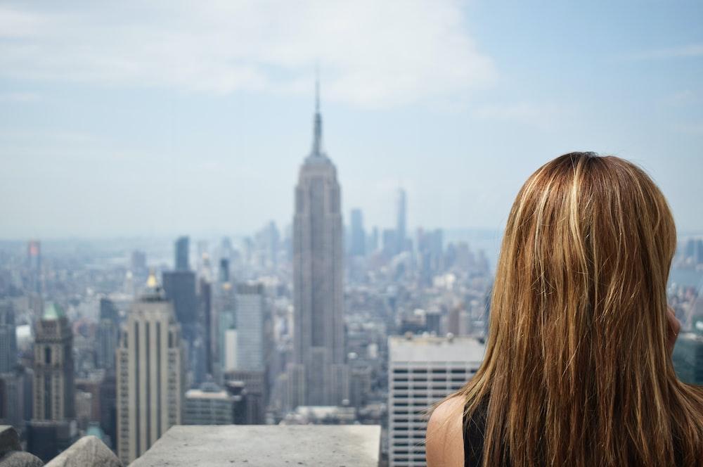 woman near high-rise buildings