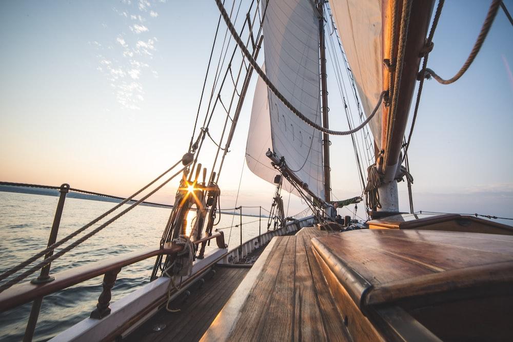 brown ship sailing on sea during daytime