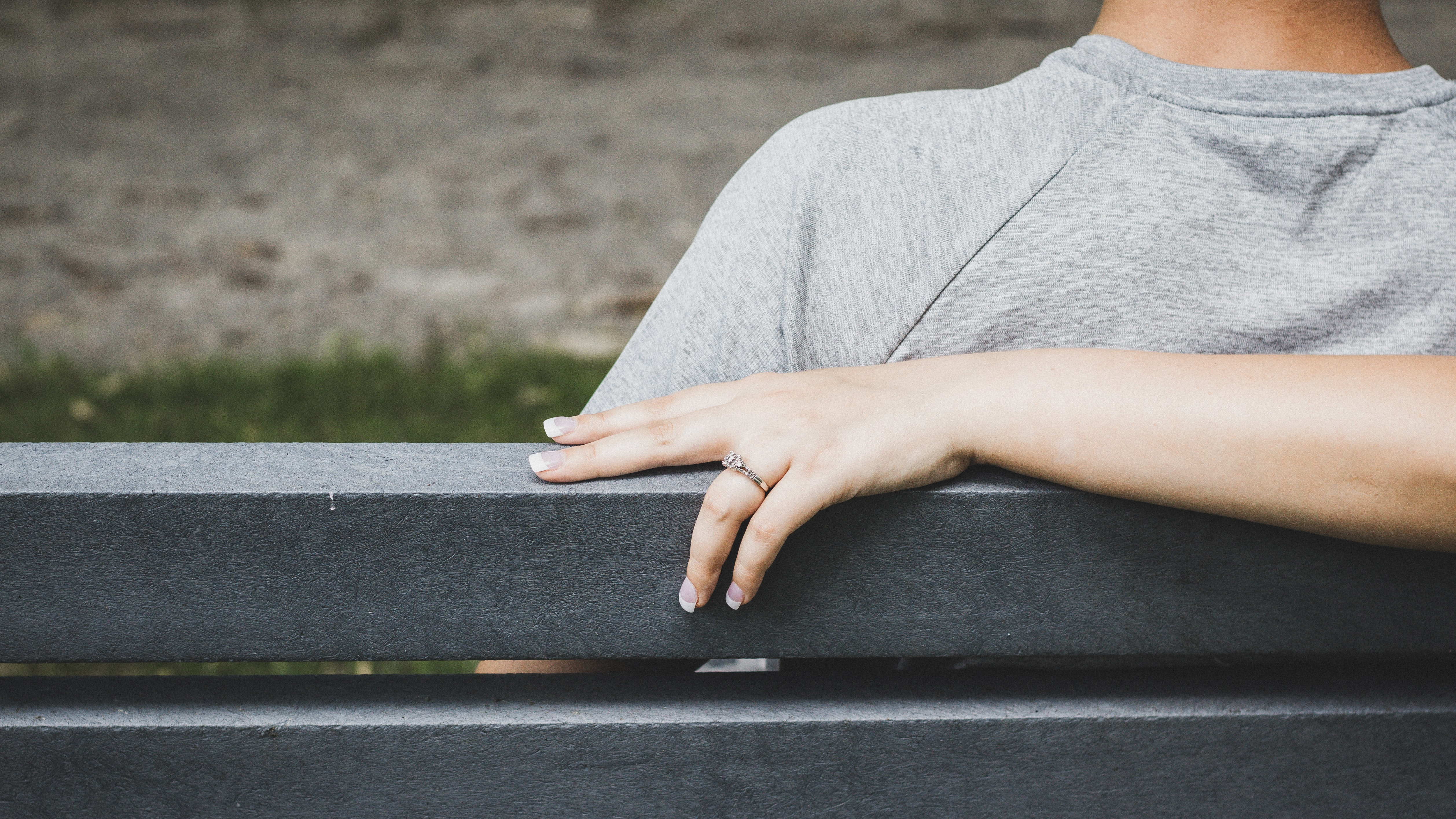 person hand holding black wooden bench