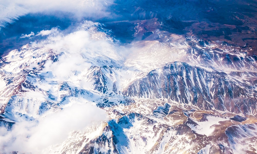 aerial photo of snow covered mountains