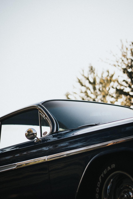 shallow focus photography of black car