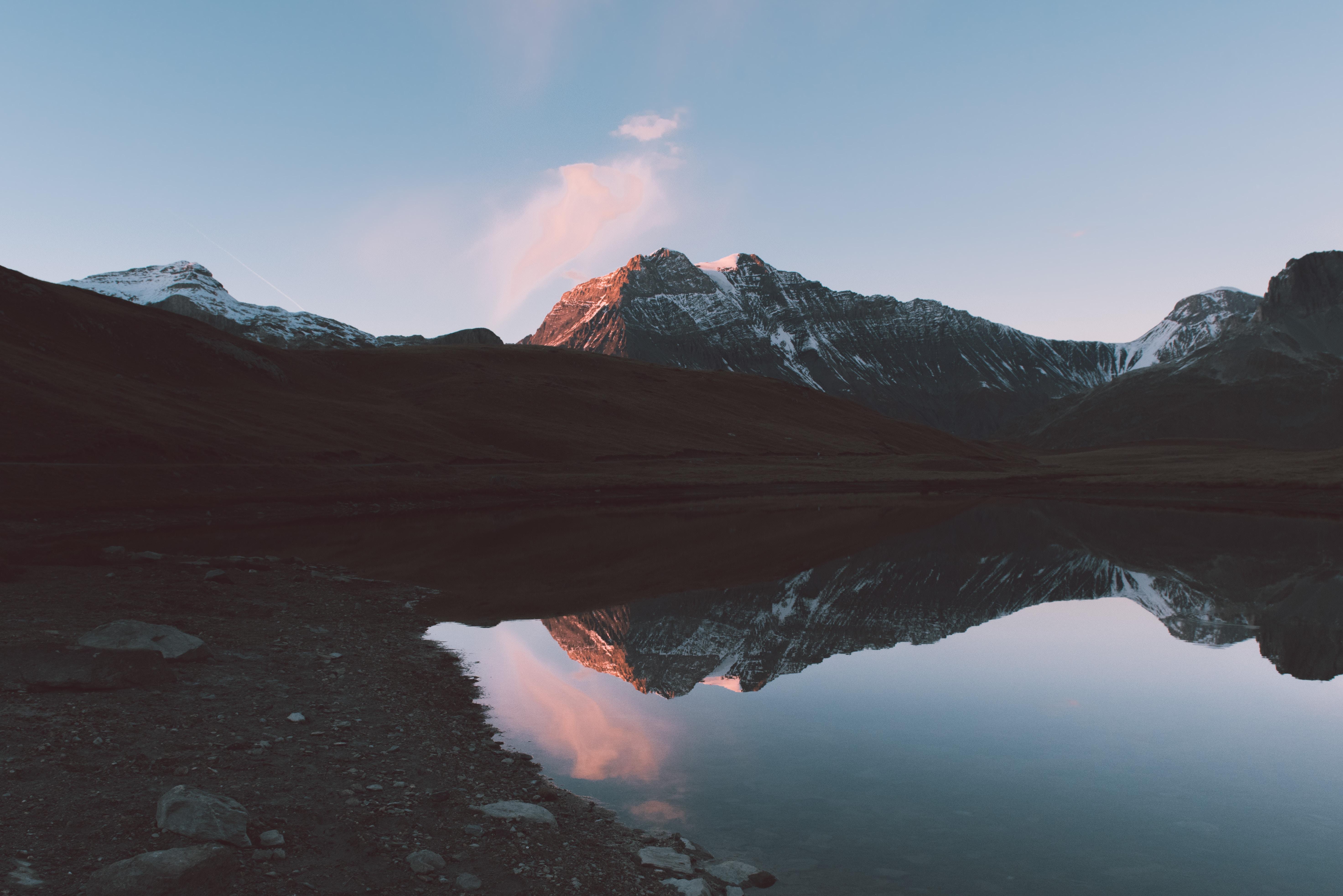 landscape photo of lake near gray mountains during daytime
