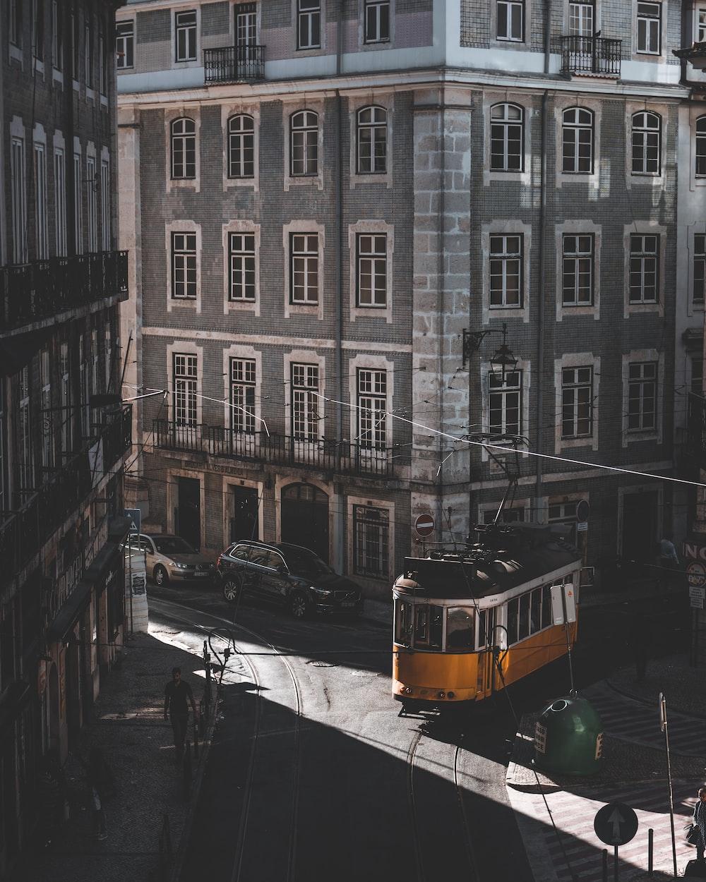 yellow tram roaming on street