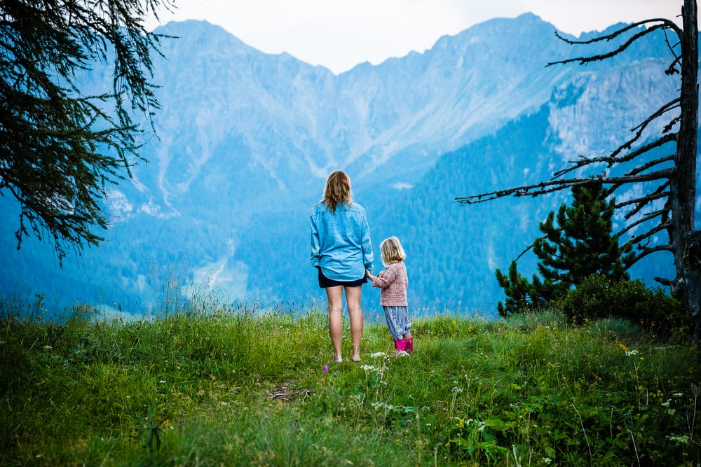 woman and child standing on mountain