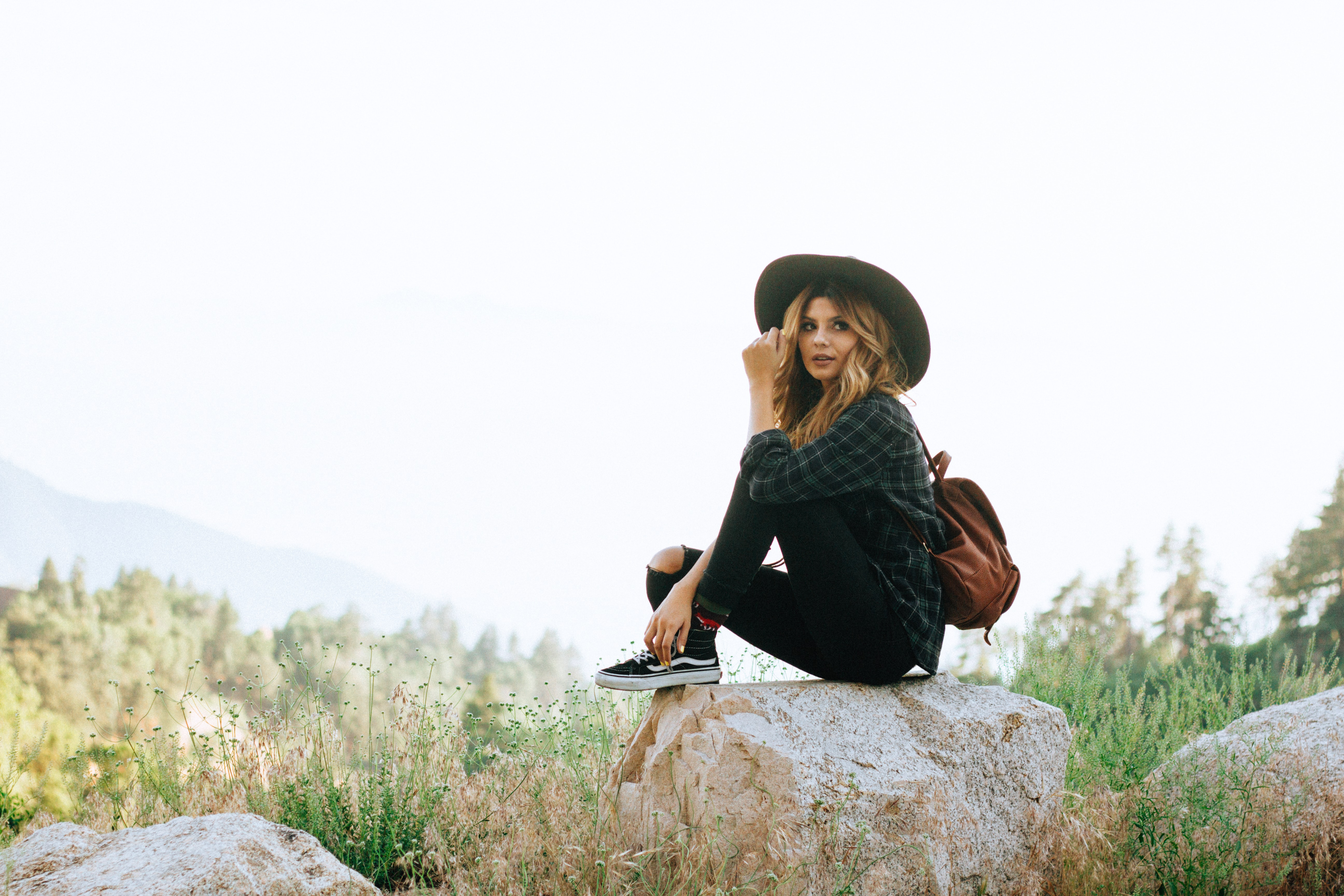 woman sitting on rock in forest