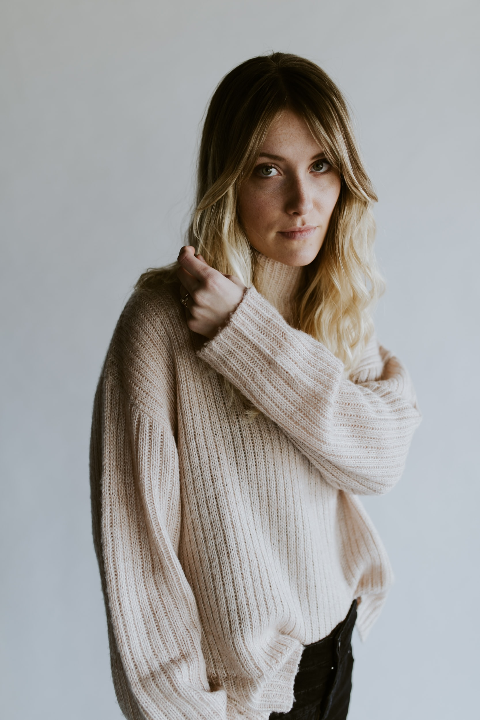 A portrait of a blonde woman wearing a sweater in Springfield