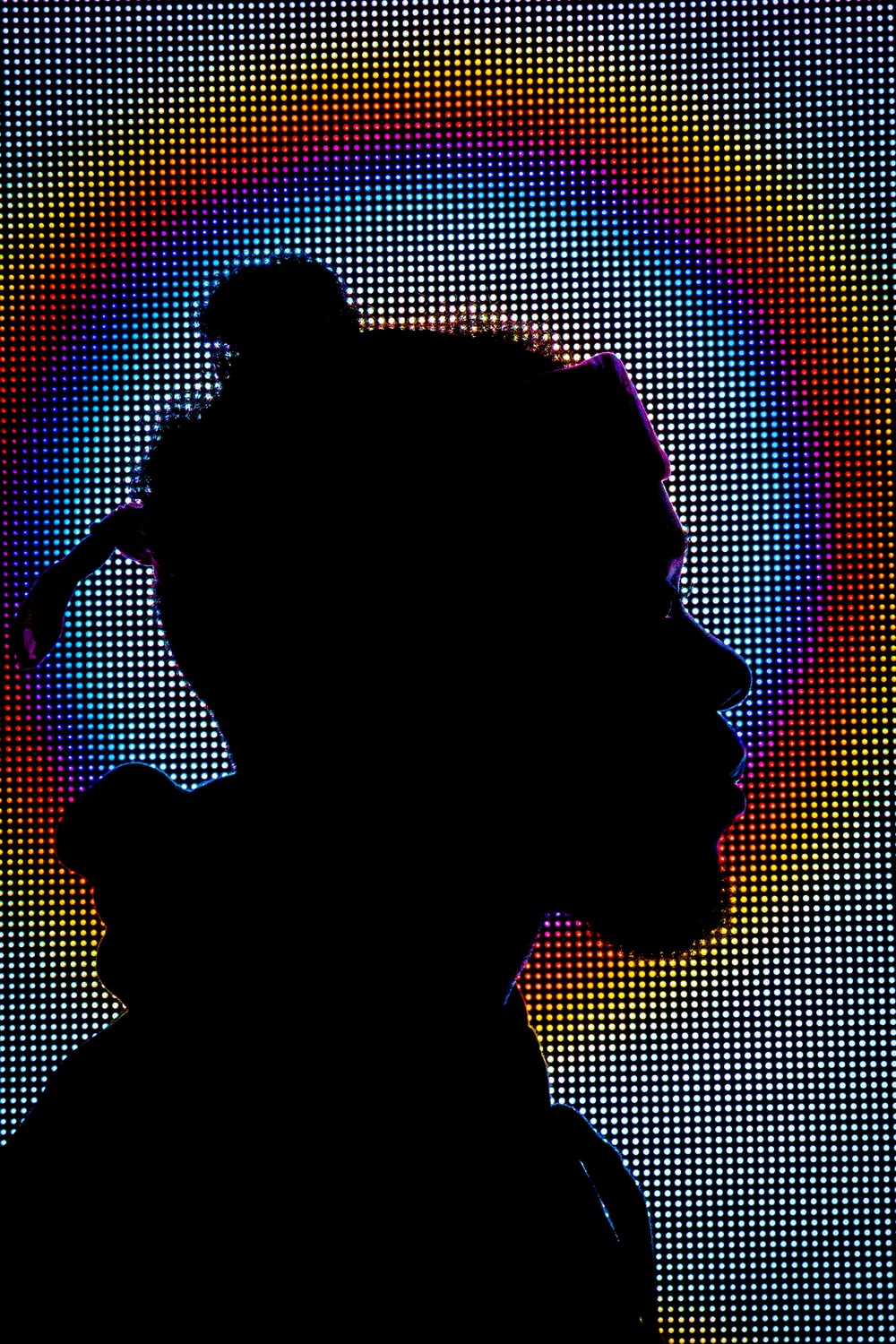 silhouette of man facing right