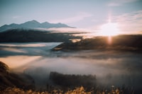 bird's eye-view photography of mountain surrounded with fog