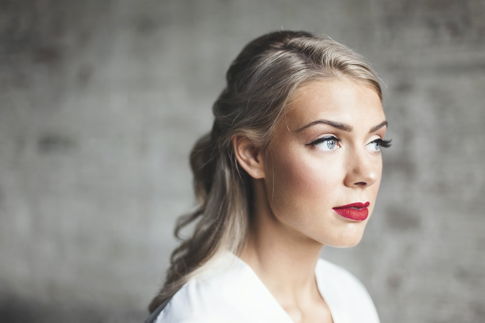 woman wearing white shirt with red lipstick