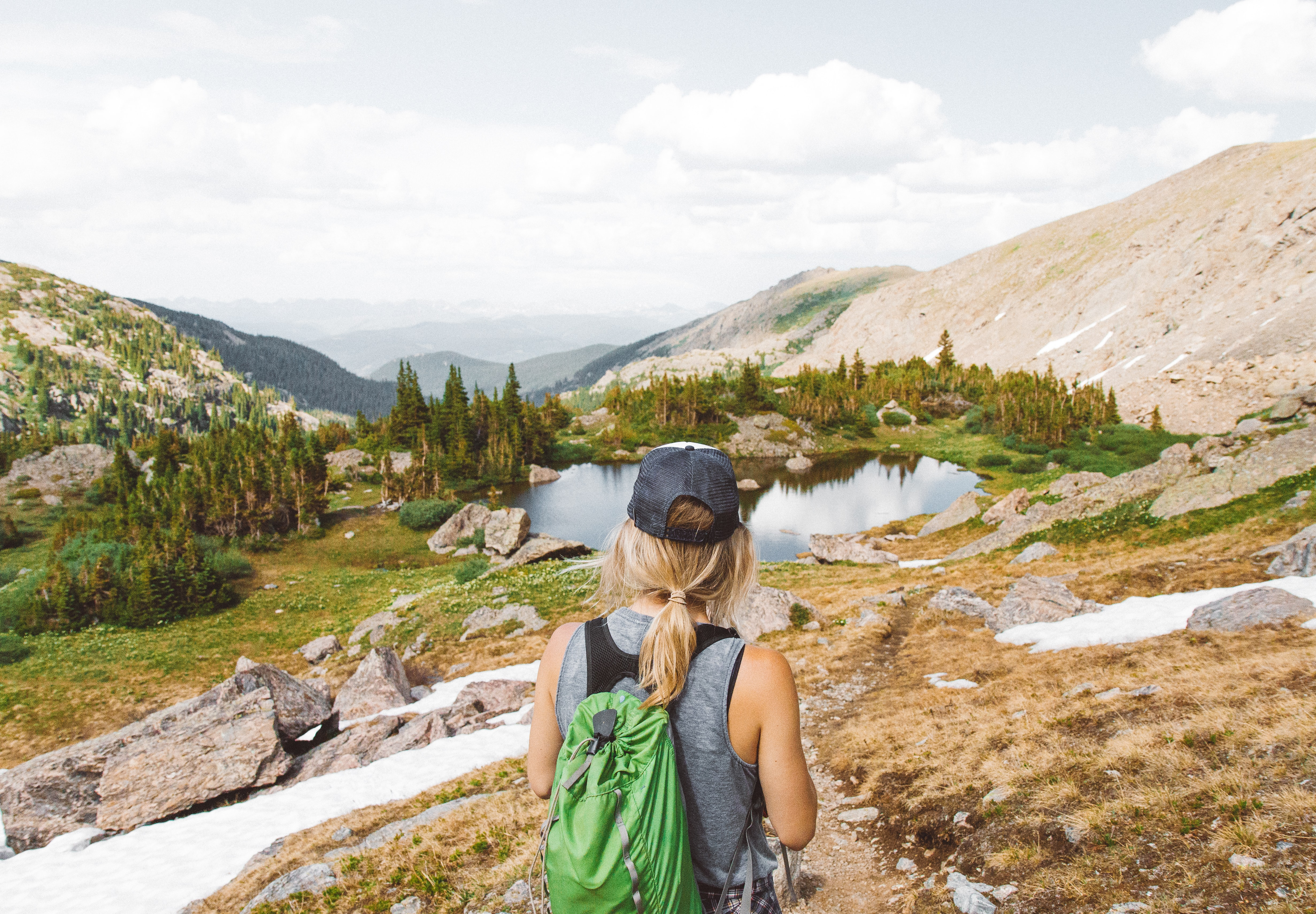 Woman looking out at a mountain landscape on a scenic hike