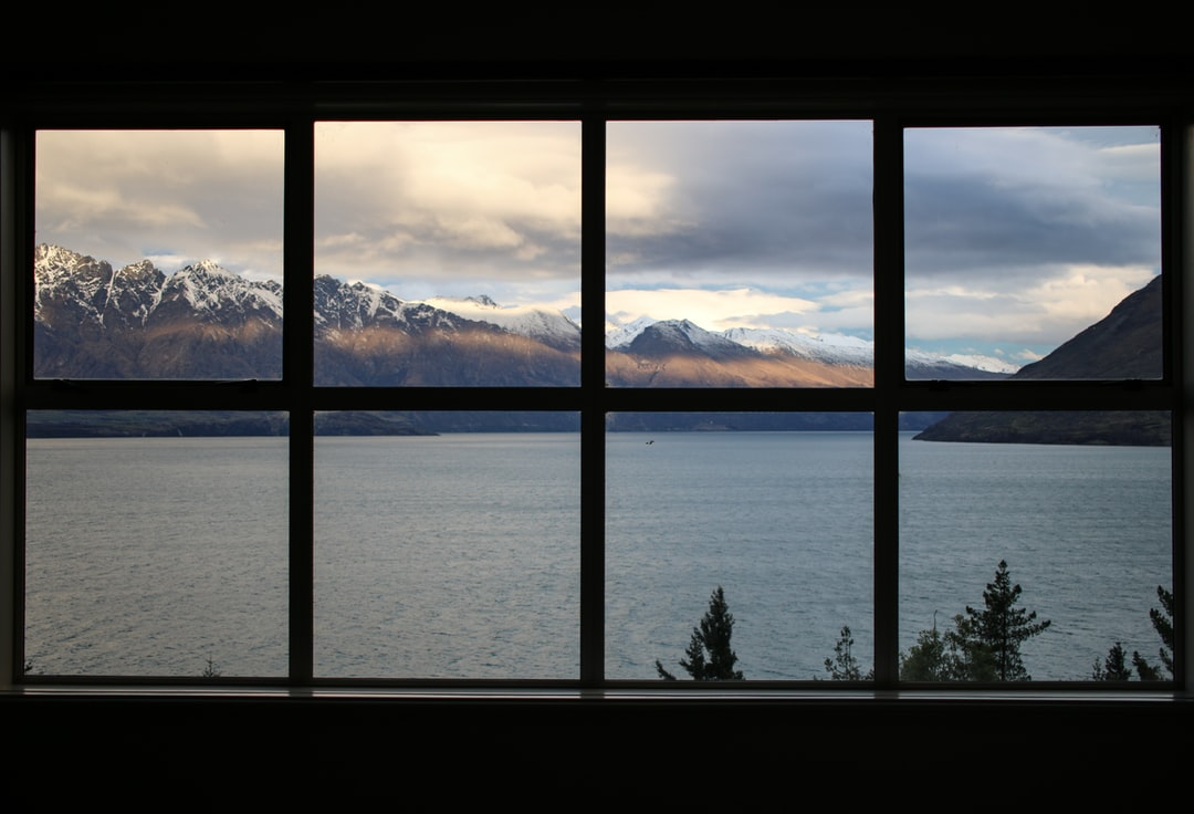 Taken in Queenstown New Zealand. Window facing Lake Wakatipu and The Remarkables at sunset times.