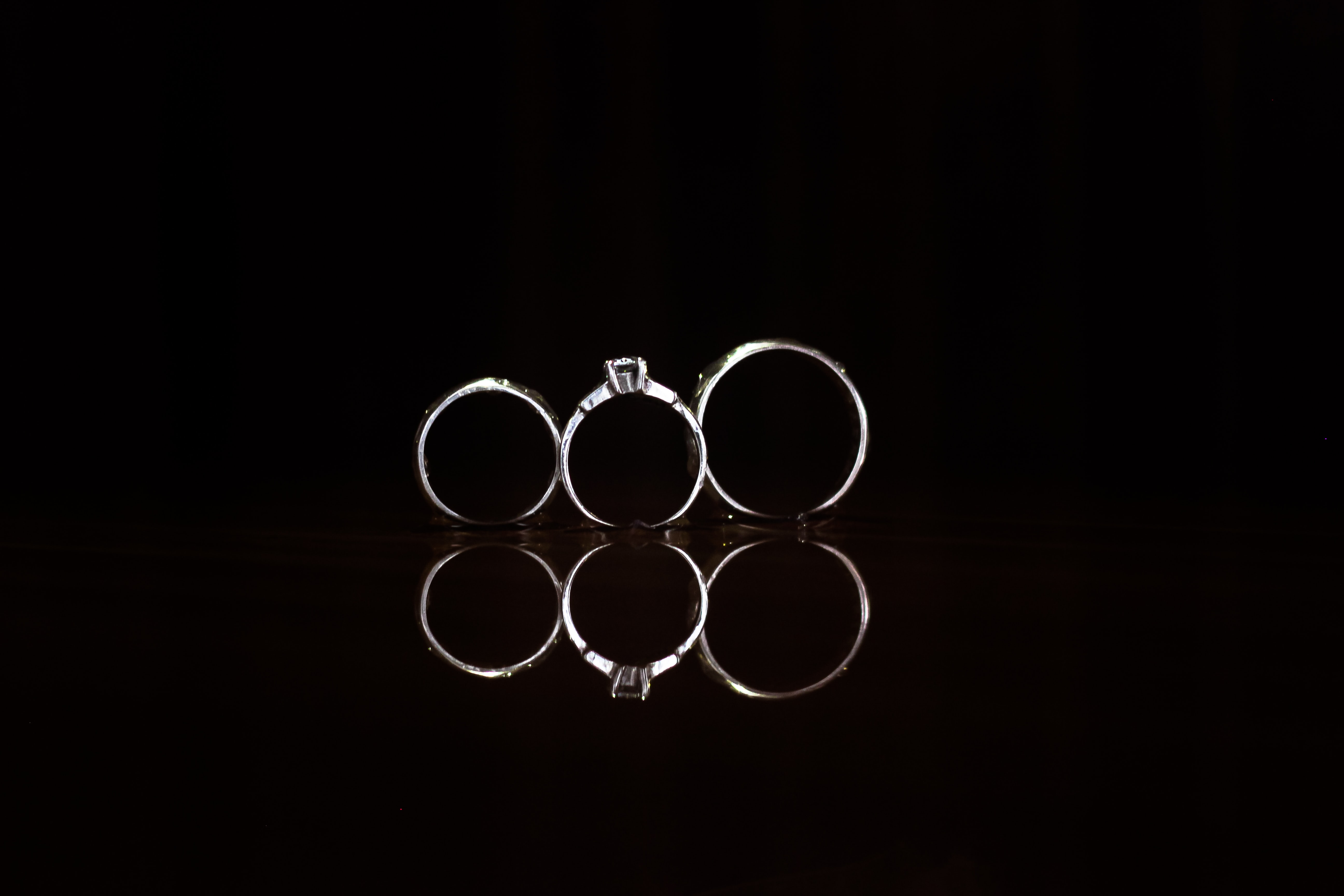 closeup photography of three silver-colored rings