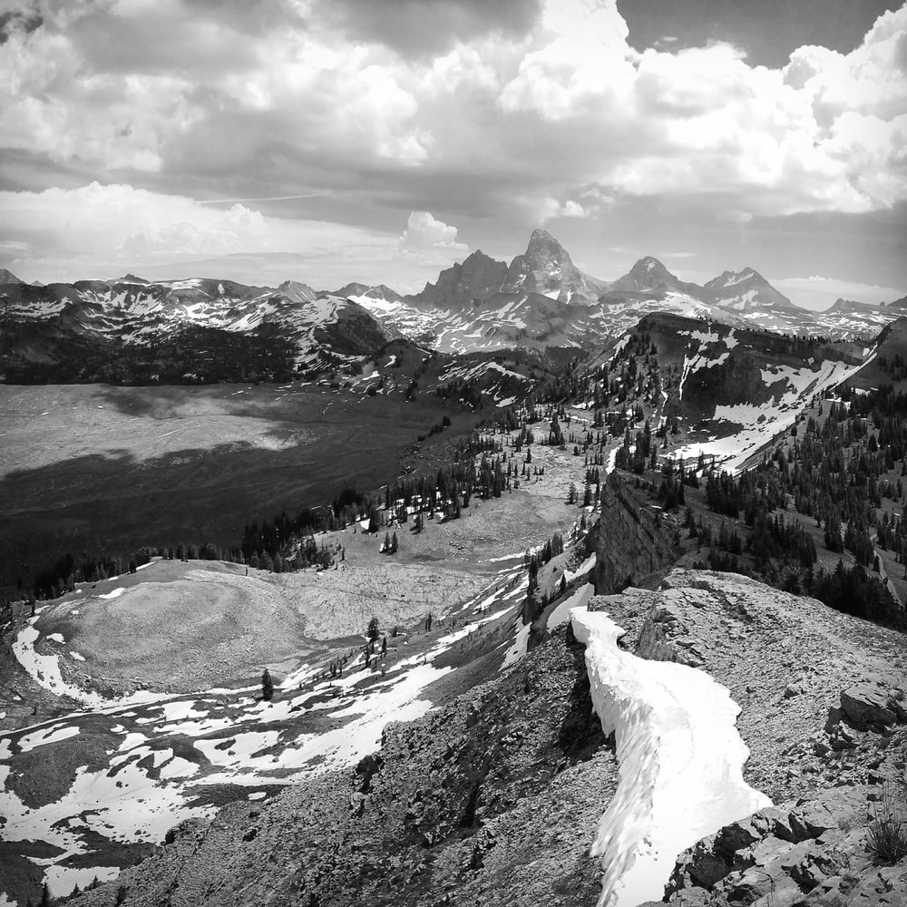 greyscale photography of mountain hill cover with snow