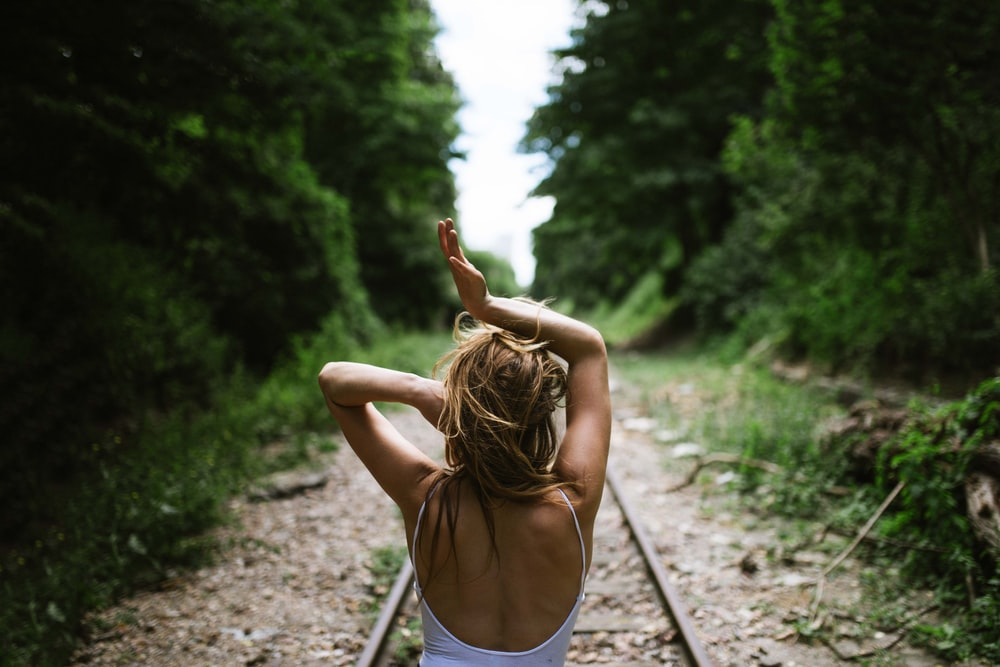 woman stand in train rail