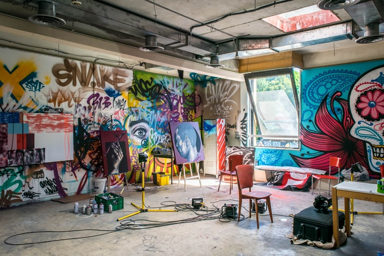 An art studio with paintings