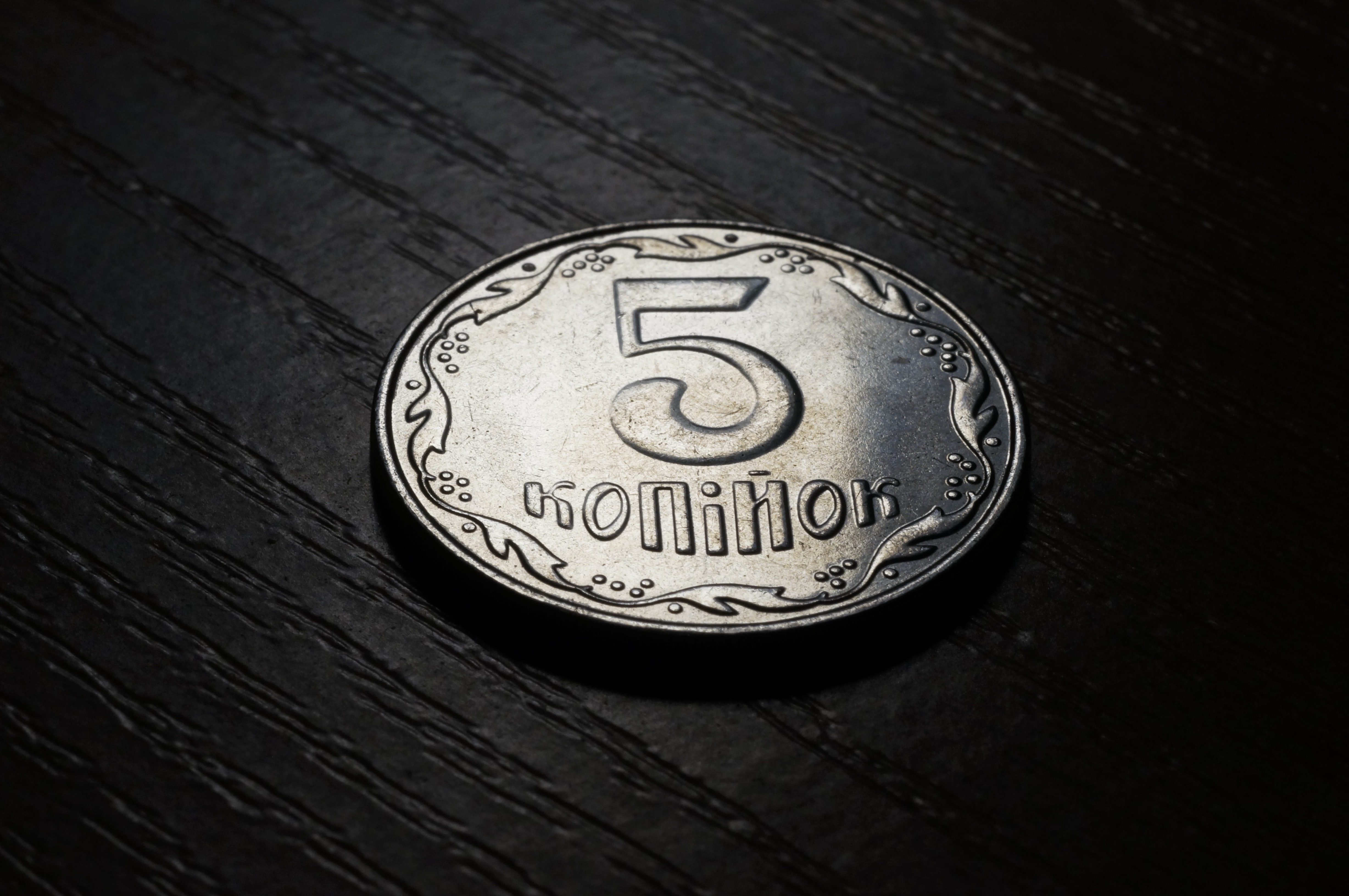 """A silver coin that says """"5 million."""""""