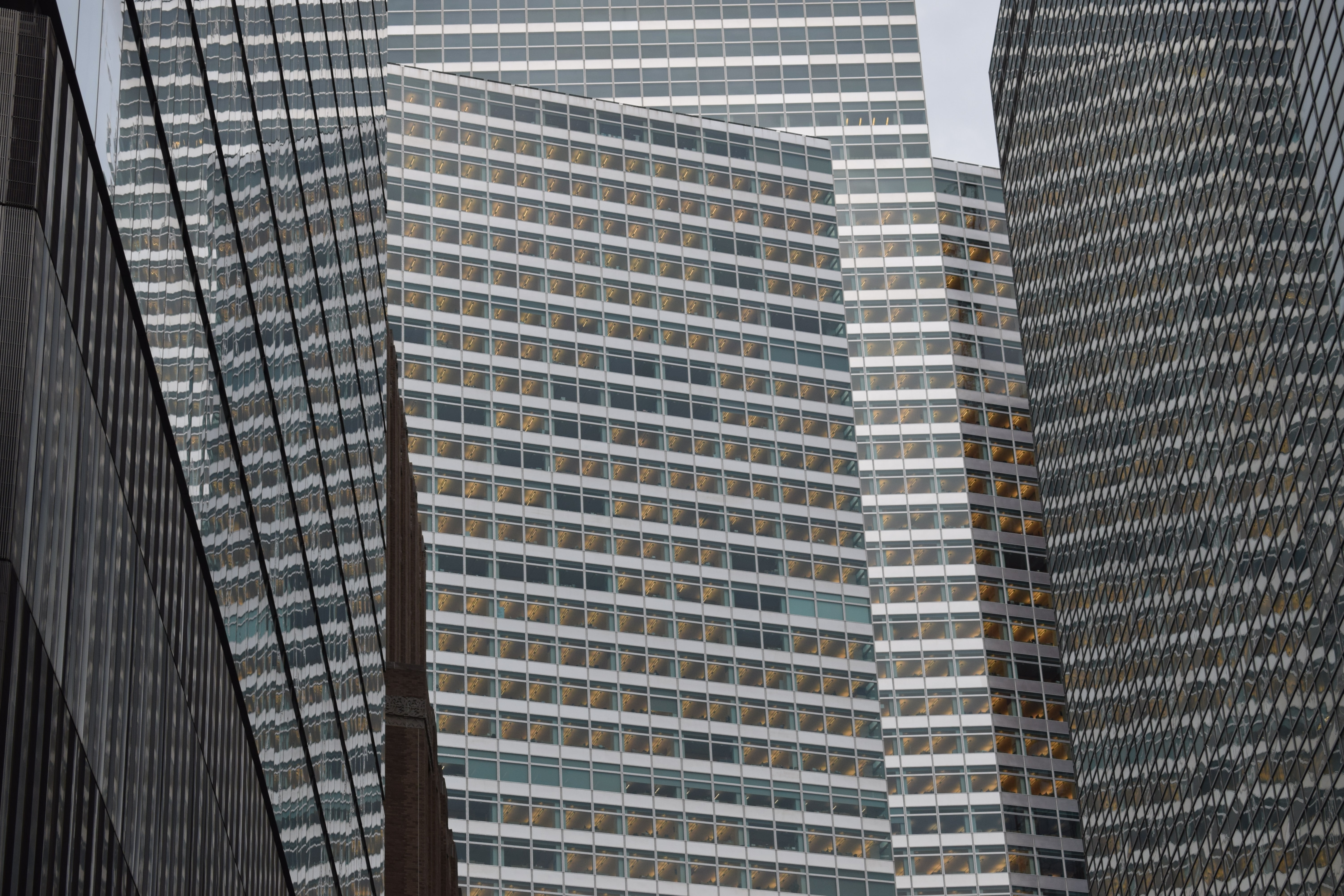 low angle photography of grey high-rise buildings