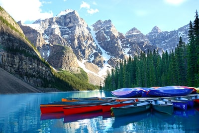 assorted-color boats on body of water banff zoom background