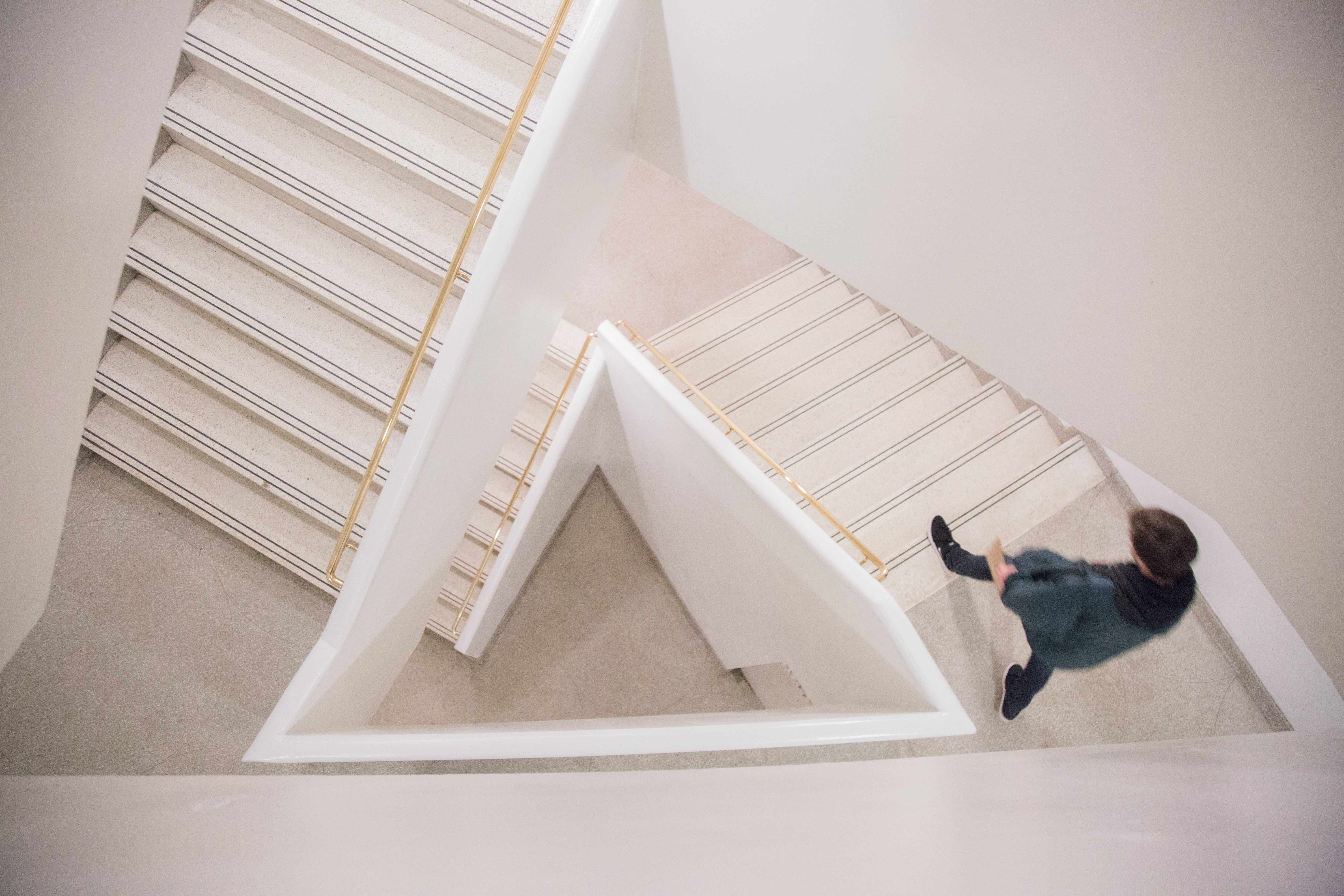 Person walks up artsy white staircase in the Guggenheim