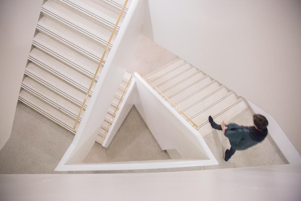 walking person on white concrete stairs