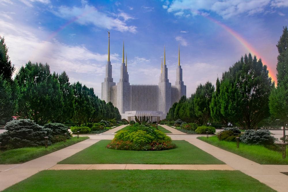 gray concrete building with rainbow illustration