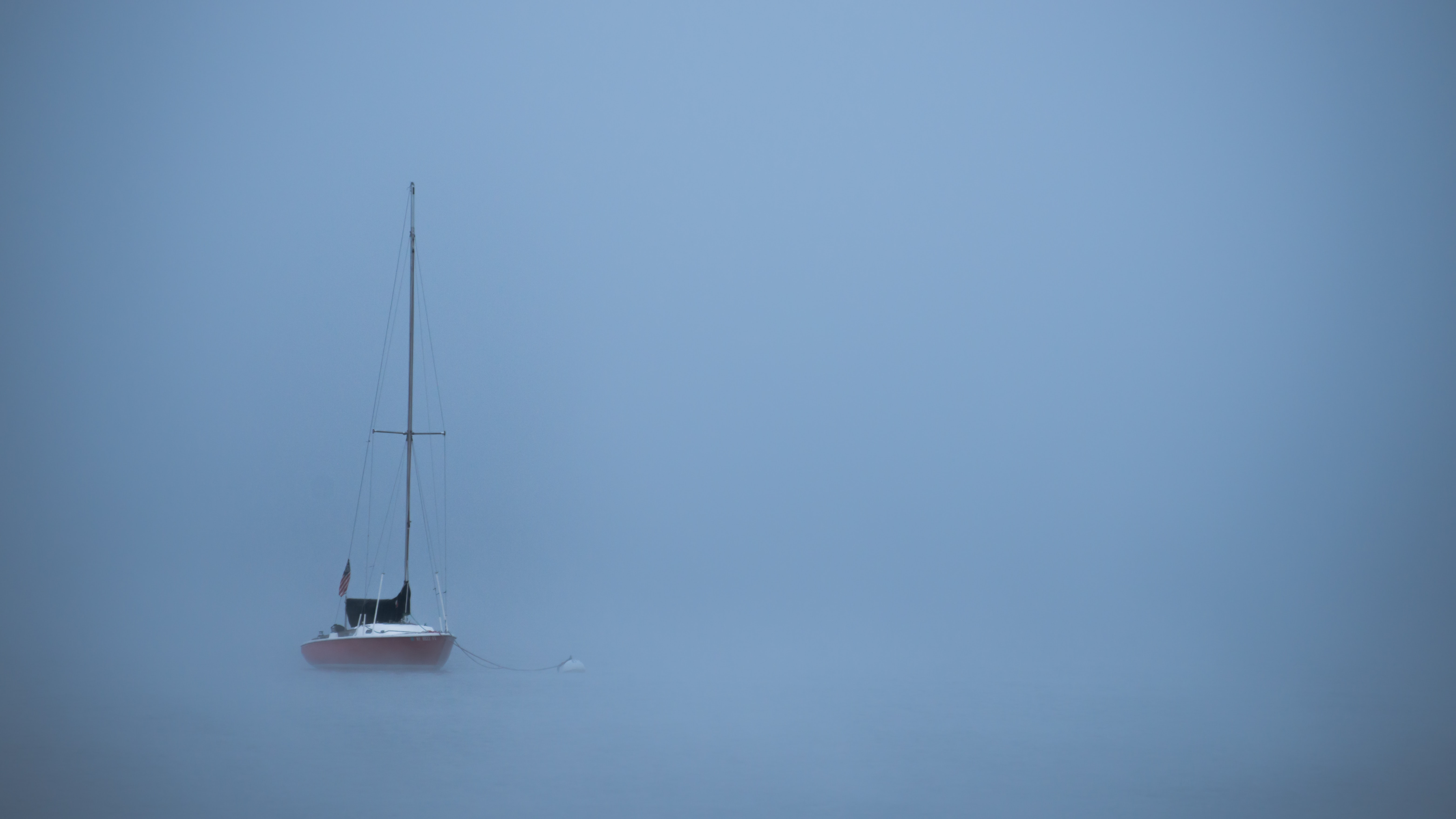 Isolated sailboat alone at sea in Chautauqua Institution