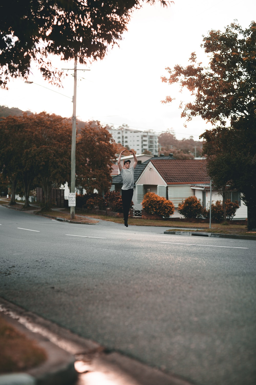 man jumped on asphalt road