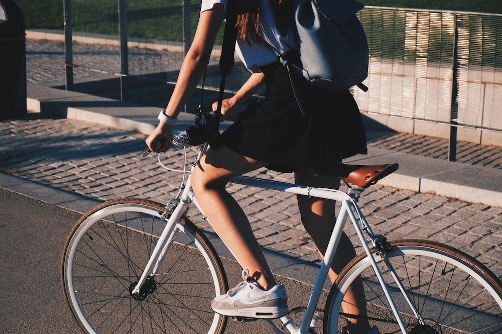 woman riding white rigid bike