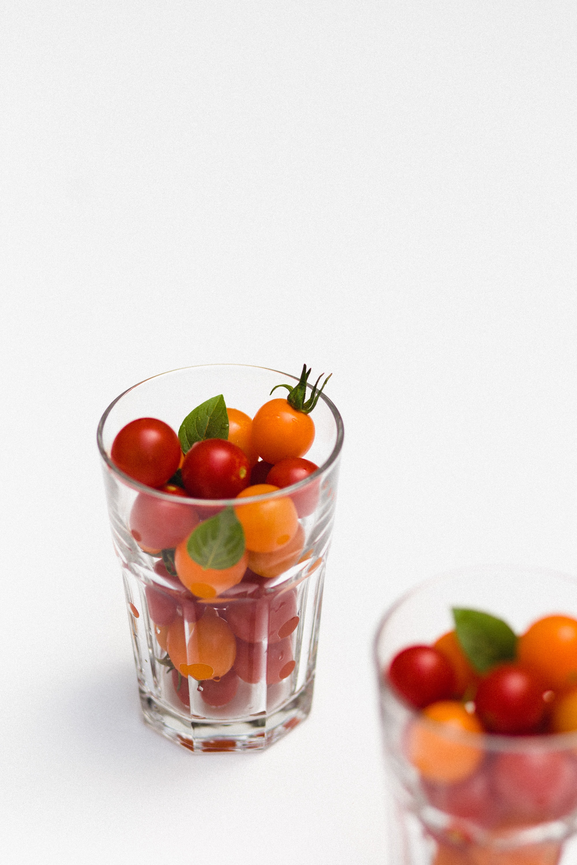 Glass cups of fresh cherry tomatoes ready to eat
