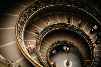 photography of people walking on stairwell