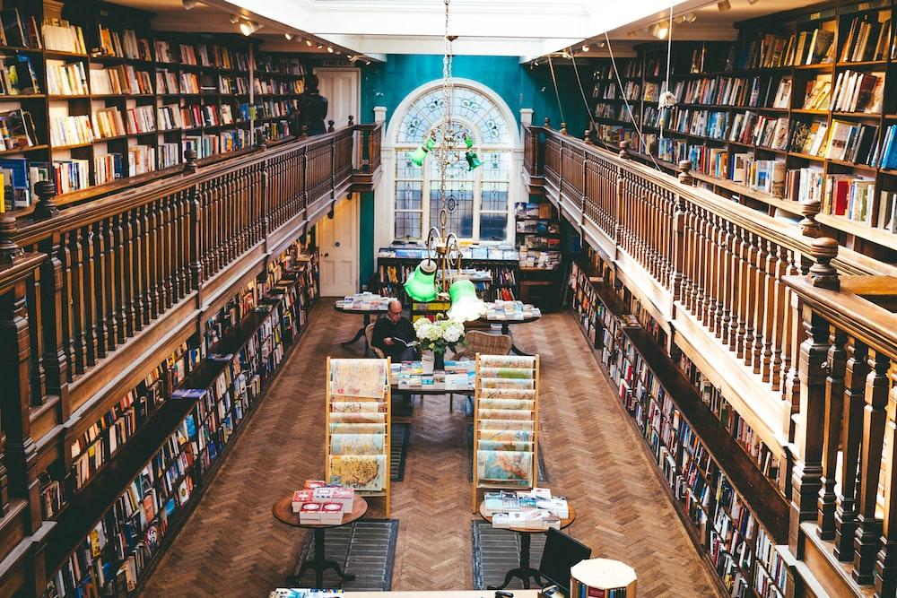 books arranged on shelves inside library