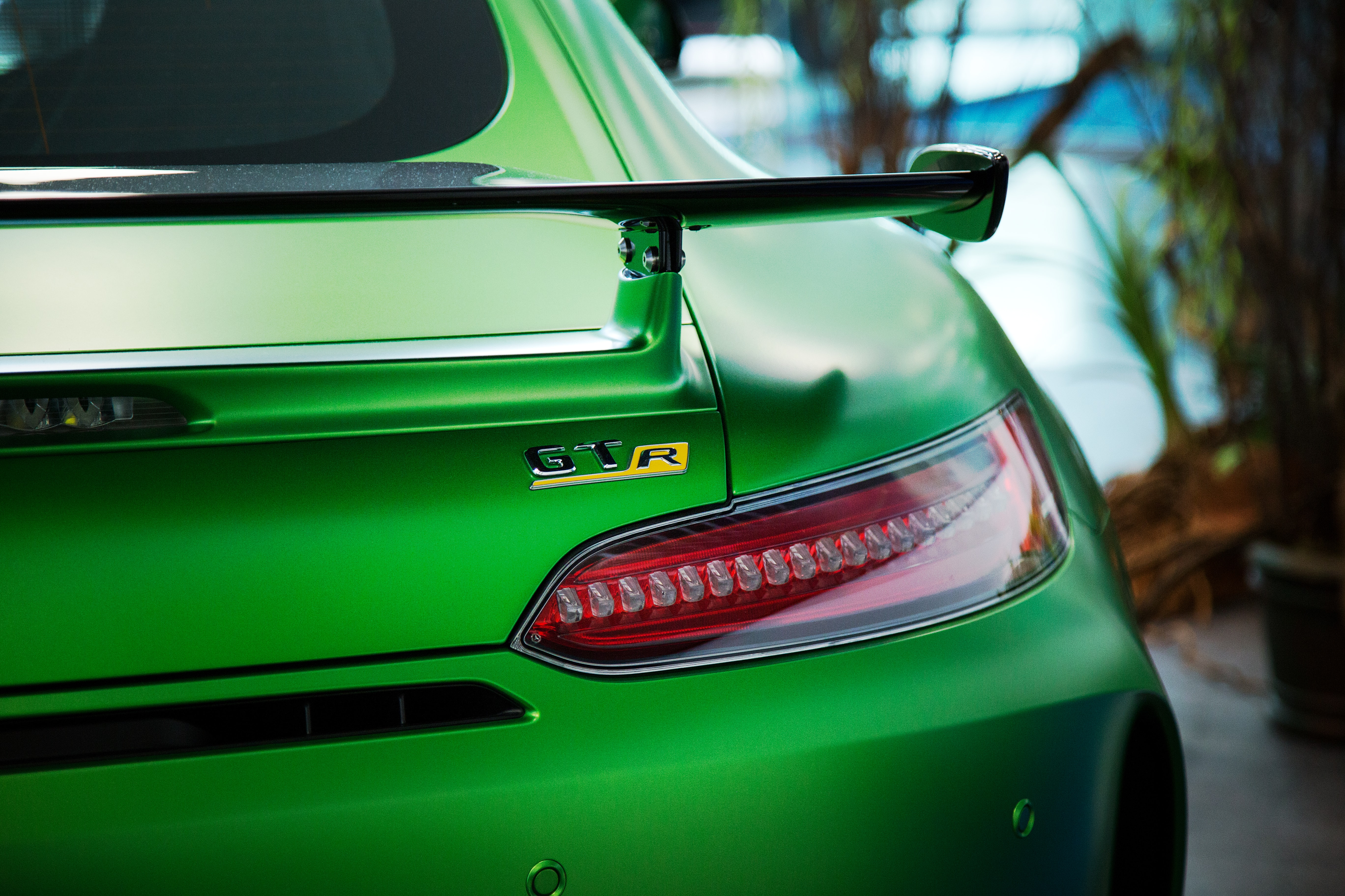 The passenger side taillight of a green car.