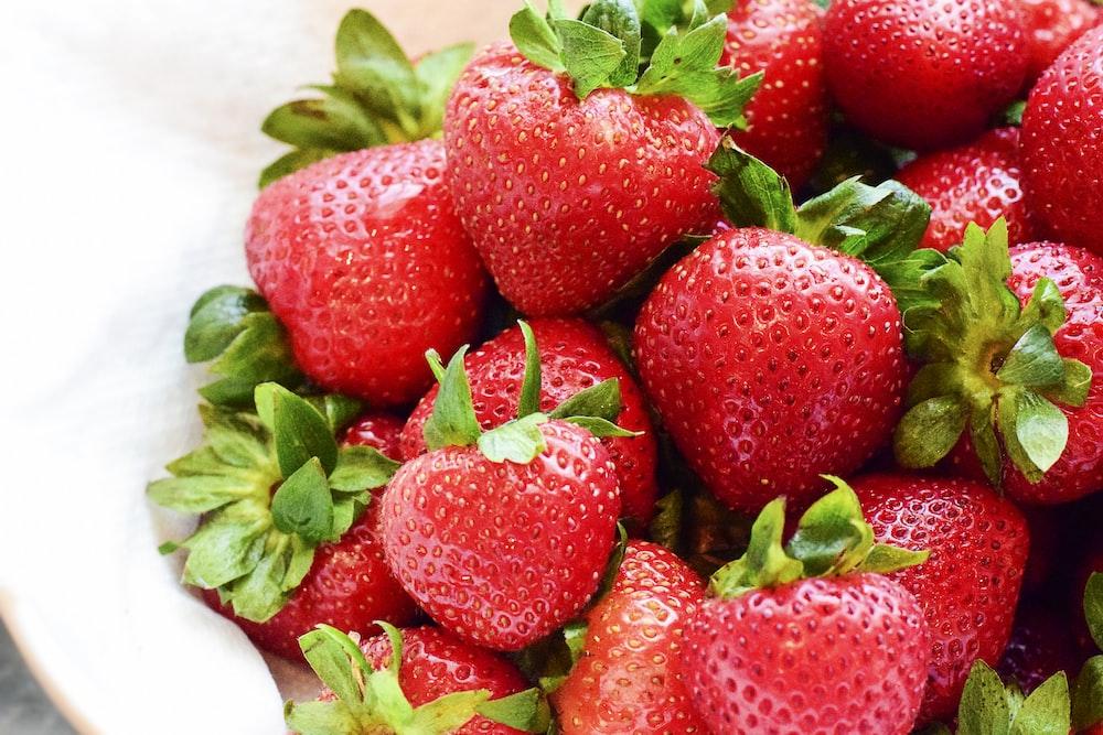 strawberries on white bowl