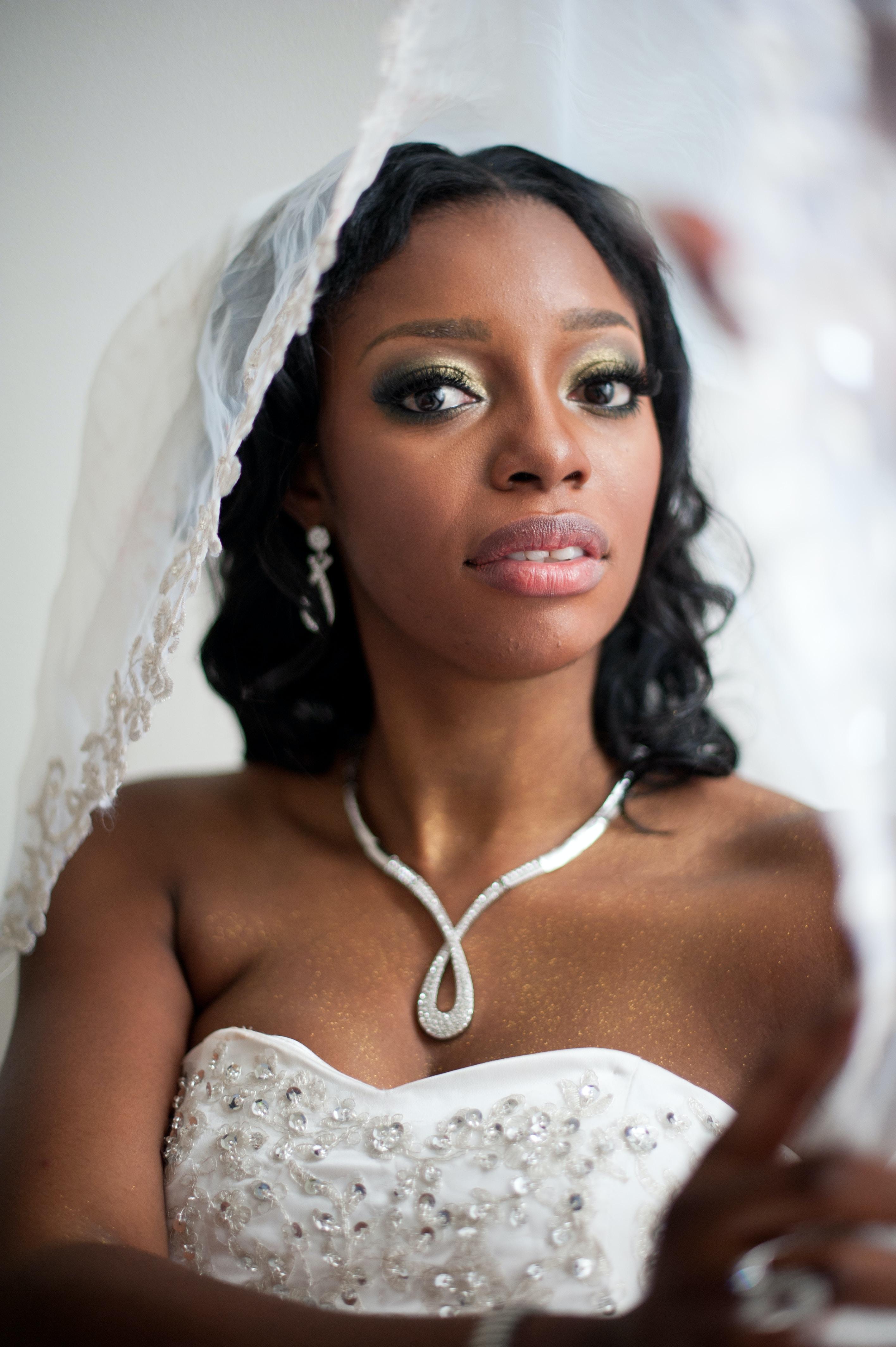 Worried bride wearing a wedding dress and veil