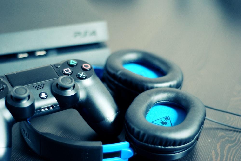 black Sony PS4 controller and black Turtle Beach headphones