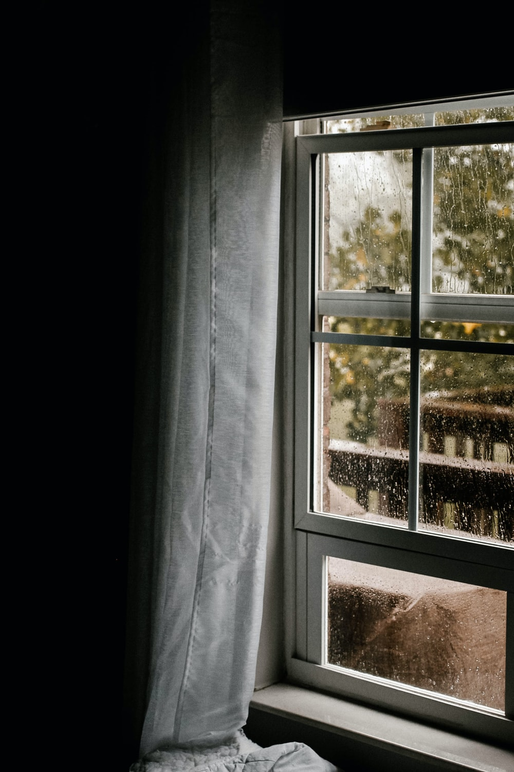 water dew on clear glass sliding window during daytime