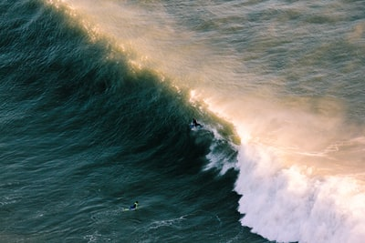 aerial view of wave of water emerald green zoom background